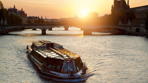 Tourist Boat on Seine River at Sunset