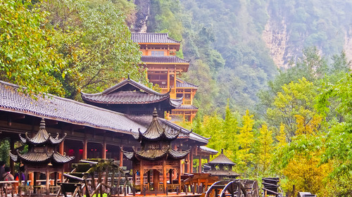 a covered corridor served as entrance to huanglong cave under mountain, zhangjiajie hunan china