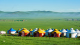 The mongolian yurts in summer grassland of Hulunbuir of China sunrise.
