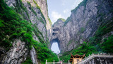Heavens door and pavilion at Tianmenshan or Mount Tianmen in the city of Zhangjiajie located in Hunan Province China.