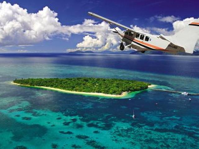 <艾尔利海滩高空观光飞机【鸟瞰心形大堡礁/白天堂沙滩/上门接送】>
