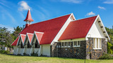 Notre Dame Auxiliatrice Church with distinctive red roof at Cap Malheureux, Mauritius, Indian Ocean