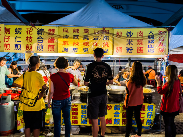 TAIPEI, TAIWAN - JULY 14: Hungry crowds eat at the Shilin Night Market food court in the Shilin District of Taipei July 14, 2013. Shilin Market is the most popular and largest night market in Taiwan.